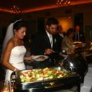 130x130 sq 1404847038117 ew bride and groom at buffet