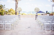 220x220_1407438397427-folding-white-chairs-on-terrace