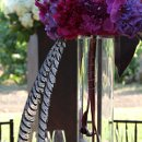 Tall feather centerpiece with deep pink peonies, orchids, hydrangea