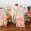 130x130 sq 1374125050402 sherbet table pinks oranges white flower centerpiece  table 1 web