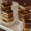 Opera- four layers of an almond jaconde soaked with rum and coffee, imbibed with rum and coffee layered with coffee buttercream and chocolate ganache. Sublime!!