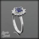 130x130 sq 1372368493901 blue sapphire white gold flower halo 3 5