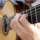 130x130 sq 1331693345768 guitarhands