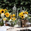 130x130 sq 1335506447881 sunflowertablescape1