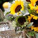 130x130 sq 1335507383126 sunflowertablescape9