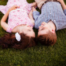 130x130 sq 1427757093405 romantic edmonton engaged couple laying in grass n