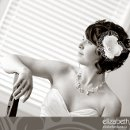 130x130 sq 1297695830899 beautifulblackandwhiteportraitofthebrideonherweddingday