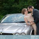 130x130 sq 1297696074443 weddingphotosphotoofthebrideandgroomtouchingnosesonajaguarcar