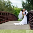 130x130 sq 1297696581750 weddingphotocouplestandingonabridgekissing
