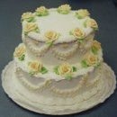 130x130 sq 1306087692084 weddingcake2tieryellowroses001