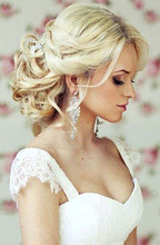 220x220 1453515645838 wedding hairstyles 6 111413