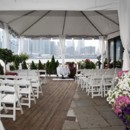 130x130 sq 1461013081254 ceremony on terrace with tent   rented white chair