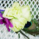 130x130 sq 1296604115049 purplegreenpeacockfeathercorsage
