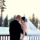 Bride and groom outside the cabin setting after a fresh blanket of snow.
