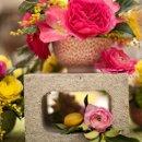 130x130 sq 1315094916015 closeuponflowersonrounds