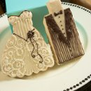 These beautifully decorated Bride and Groom cookies are the perfect wedding favors! Each cookie is decorated by hand and comes individually wrapped and ready to place at your reception table settings. Price is for the pair, including the bride and the groom cookie. Minimum order is 24 cookies. Advantage Bridal is pleased to offer fast shipping and a low price guarantee.