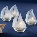 "Perfect for a beach wedding or a function by the sea. What Is more romantic image than candle-lit sailboats on a nighttime harbor, each one glowing with ambiance? These charming tealight holders make an impeccable presentation at every place setting, as the tealights within illuminate their frosted glass sails. They work great with springtime, summertime, or nautically themed weddings, especially. Sold in sets of four tealight candles included. Each sailboat measures 3"" x 3.5"". Sold as a set of a 4 with an option for personalized tags. Advantage Bridal is pleased to offer fast shipping and a low price guarantee."