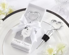 "This is the perfect party favor! Give your guests a piece of your heart with this fabulous Heart Bottle Stopper. Along with the graceful chrome heart that sits atop the bottle stopper, the lovely wedding-white gift presentation speaks for itself. Advantage Bridal is pleased to offer fast shipping and a low price guarantee on all of their products. More Details about these favors: •A chrome heart design tops this meaningful bottle stopper •Bottle stopper is 4 1/2"" long and comes with a white box, a white-satin ribbon and bow and a matching ""For You"" tag •Gift box measures 5 3/4"" h x 2 1/4"" w x 1/2"" d"