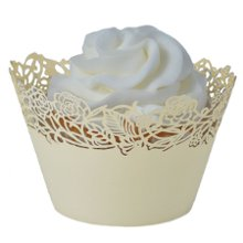 "These fabulous ivory Rose Vine-design laser-cut cupcake wrappers are sold in a set of 12. They easily assemble to slip your favorite cupcake or candy-filled cup into for a marvelous display. Create a beautiful cupcake tree, set at each place setting as a party favor, the possibilities are endless. And with fast shipping and a low price guarantee, the cupcake wrappers are an even better addition to your special occasion! Wrappers are for presentation purposes only - not to bake in and measure 3-1/4"" round x 2-1/8"" high."