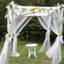 Rustic arbor, with white flowers and tulle or add your own colors like these sunflowers