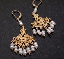 220x220_1254411690332-goldpearlchandelier