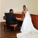 130x130 sq 1315687848885 playingpiano