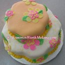 Luau 2-tier fondant covered cake created for a second wedding. To see more of the best cakes in Rocky Mount, NC and all of Eastern North Carolina visit our website at amemoryworthmaking.com or become a fan of our Facebook page for more photos. www.facebook.com /amwmc.