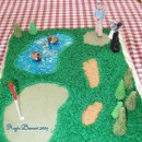 Grooms cake with cream cheese base with fondant and gumpaste decorations - golfer, golf clubs, geese, trees and more. To see more of the best cakes in Rocky Mount, NC and all of Eastern North Carolina visit our website at amemoryworthmaking.com or become a fan of our Facebook page for more photos. www.facebook.com /amwmc.