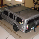 Rear view of a groom's cake in the likeness of his vehicle.