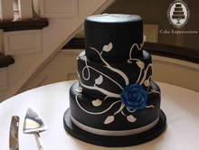 220x220 1377818425194 black and white rose wedding cake ow