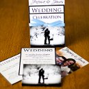 130x130 sq 1301681279943 blackandbluetieredphotocardweddinginvitations130
