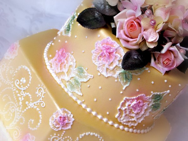 600x600 1297269864460 brushembroiderycloseupcakeyellowwedding