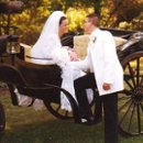 130x130 sq 1257218233044 brideandgroomcloseupinbrowncarriage
