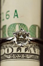 220x220 1326311340909 weddingringmoney