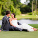 130x130 sq 1427655697693 bride and groom laying on the golf course litchfie
