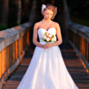 130x130 sq 1427656538436 bride standing on pier in the sunset pawleys islan