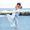130x130 sq 1427656614551 lifting up bride for a kiss  2013