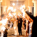 130x130 sq 1427657670332 bride and groom running through sparklers.  there