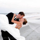 130x130 sq 1427657976233 groom holding the bride in his arms ocean club gra