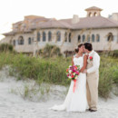 130x130 sq 1443811202536 bride and groom kissing in front of the dunes 1500