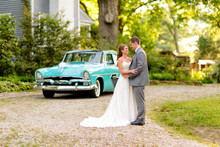 220x220 1427775082250 couple standing in front of a classic car the ivy