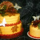 Fall wedding cake with the bride and groom cake separate.