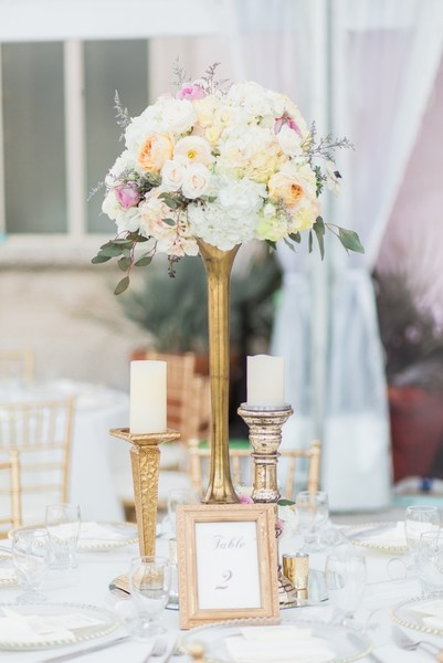 1493333822050 Candlestick Candelabra With Blush Flowers Gold Mer Miami wedding catering