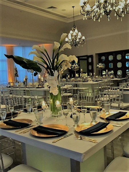 1504053022280 Calla And Orchid Tall Centerpiece Bath Club Miami wedding catering