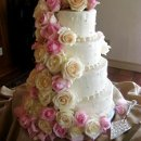130x130 sq 1275923296858 weddingcakepinkwhiteroses