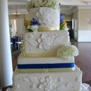 130x130 sq 1306601134582 4tierwhiteblueyelloweddingcake