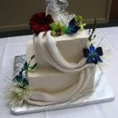 130x130_sq_1306601138317-buttercreamivoryfreshflowercake
