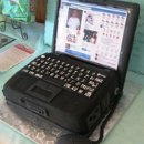 130x130 sq 1306603100723 laptopgroomscake