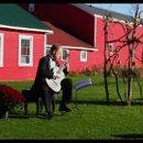 130x130 sq 1274873410741 guitaristoutdoorwedding
