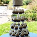 130x130 sq 1348455111999 chocolatebrownandivorycupcakeweddingsept2012